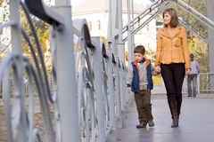 Mother and son walking  across the bridge Stock Photography