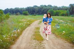 Mother and son walking on country road Royalty Free Stock Images