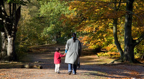 Mother and Son Walking in the Forest Stock Images