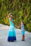 Mother and son walking in garden Royalty Free Stock Photo