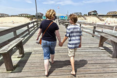 Mother and son walking hand in hand Stock Images