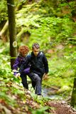 Mother and son walking on a hike trail Stock Photography