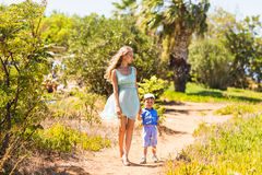 Mother and son walking on nature. Outdoors Royalty Free Stock Photos