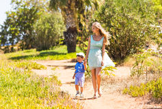 Mother and son walking on nature. Outdoors Royalty Free Stock Photo