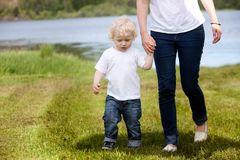 Mother and Son Walking Near Lake Royalty Free Stock Photo
