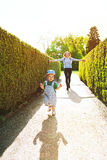 Mother and son walking outdoors on the nature background with co Stock Photos