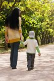 Mother and son walking in park Royalty Free Stock Image