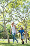 Mother and son walking in the park with football. On a sunny day Royalty Free Stock Images