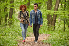 Mother and son walking through the park. Forest Royalty Free Stock Photo