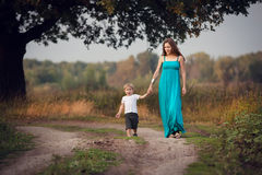 Mother and son walking by the road  in countryside Stock Images