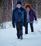 Mother and son walking through the snow Stock Photography