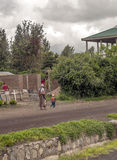 Mother and son walking. Through the streets of Tanzania on a cloudy day. is a vertical picture taken in May 2014 Royalty Free Stock Image