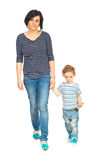 Mother and son walking together Royalty Free Stock Images