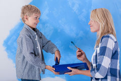 Mother and son during wall painting Royalty Free Stock Photography