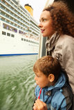 Mother and son watch on cruiser from boat Stock Image