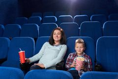 Mother and son watching movie in cinema. stock photo
