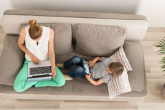 Mother And Son Watching Videos stock photography