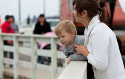 Mother and son watching wildlife from a pier Royalty Free Stock Photography