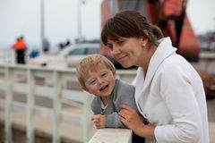 Mother and son watching wildlife from a pier Royalty Free Stock Photos