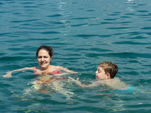 Mother and son in the water Royalty Free Stock Photo