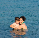 Mother and son in the water Stock Photo