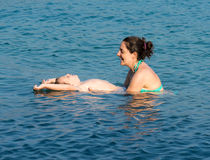 Mother and son in the water Stock Photography