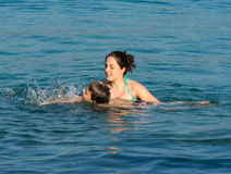 Mother and son in the water Stock Photos