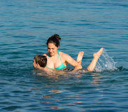 Mother and son in the water Royalty Free Stock Image