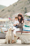 Mother and son on the waterfront with a dog. Royalty Free Stock Images