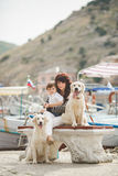 Mother and son on the waterfront with a dog. Royalty Free Stock Image