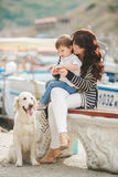 Mother and son on the waterfront with a dog. Royalty Free Stock Photos