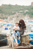 Mother and son on the waterfront with a dog. Royalty Free Stock Photography