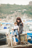 Mother and son on the waterfront with a dog. Royalty Free Stock Photo