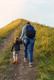 Mother and son went up the hill. Royalty Free Stock Photo