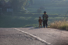 Mother and son were walking home after work. Royalty Free Stock Photos