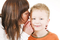 Mother and son whispering Stock Photo