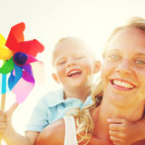 Mother Son Windmill Sea Vacation Holiday Piggyback Concept Stock Image