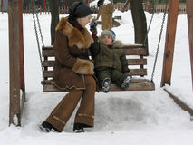 Mother with son . winter. Mother with son on bench. winter royalty free stock images