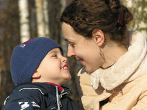 Mother with son. winter sun. Mother with son faces. november royalty free stock images