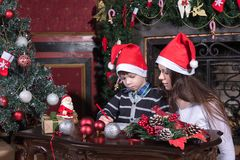 Mother and son writing letter to Santa stock image