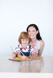 Mother and son writing and smiling to the camera Stock Photo