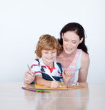 Mother and son writing together Stock Image