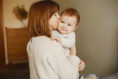 Mother with son. Young and pretty mother playing with hre son at home royalty free stock images