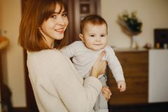 Mother with son. Young and pretty mother playing with hre son at home royalty free stock photos