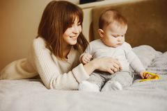 Mother with son. Young and pretty mother playing with hre son at home stock photos
