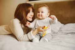 Mother with son. Young and pretty mother playing with hre son at home stock images