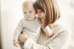 Mother with son. Young and pretty mother playing with hre son at home royalty free stock image