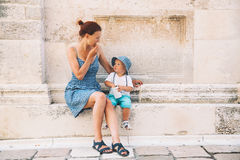 Mother and son in Zadar, Croatia. Summer holidays on the seacoast of Europe. Tourists walking on the old historical streets of Zadar. Lifestyles, Family royalty free stock images