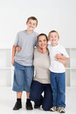 Mother and sons. A happy mother and sons hugging on white background Stock Photos