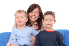 Mother and sons. Mother and two sons  on the sofa - portrait Stock Photos
